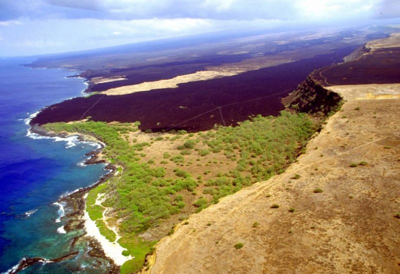 Lava flow from cliffs to sea.
