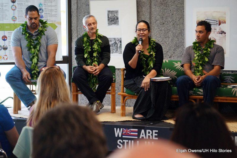 Seated at the front of the audience: Kealaka'i Kanaka'ole, Christian Giardina, Ku'ulei Kanahele, and Luka Mossman. Ku'ulei is speaking into a microphone.