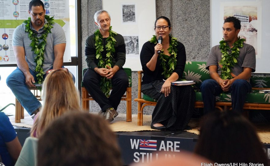Seated at the front of the audience: Kealaka'i Kanaka'ole, Christian Giardina, Ku'ulei Kanahele, and Luka Mossman. Ku'ulei is speaking into a microphone.