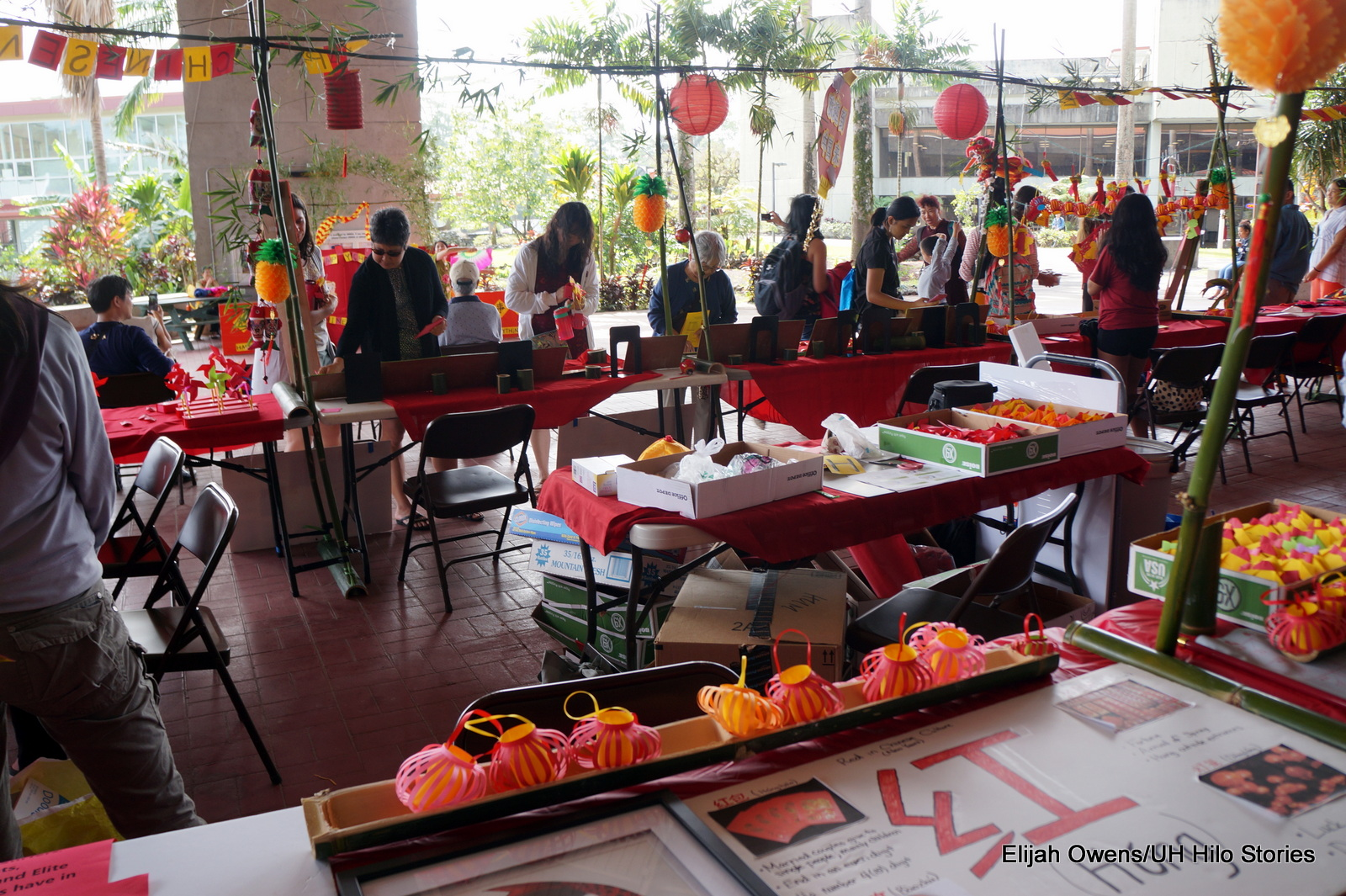 Display tables, lots of red fabrics and paper, dangling Chinese lanterns.