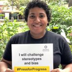 "With sign, ""I will challenge stereotypes and bias."""