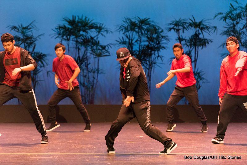 Group in modern black leggings (men in black jeans), black sneakers, and red tops, doing hip hop dance.