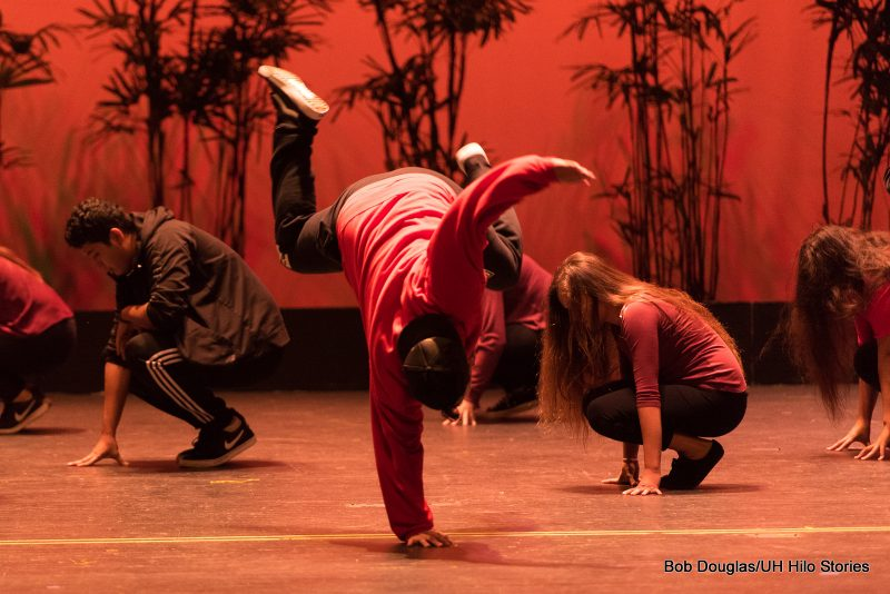 Group in modern black leggings (men in black jeans), black sneakers, and red tops, doing hip hop dance.