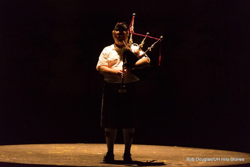 Man playing bagpipe.