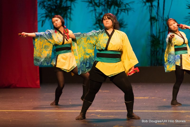 Dancers in Japanese costume green and yellow.
