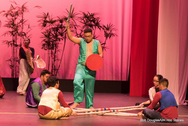 Tinikling, solo male in green.