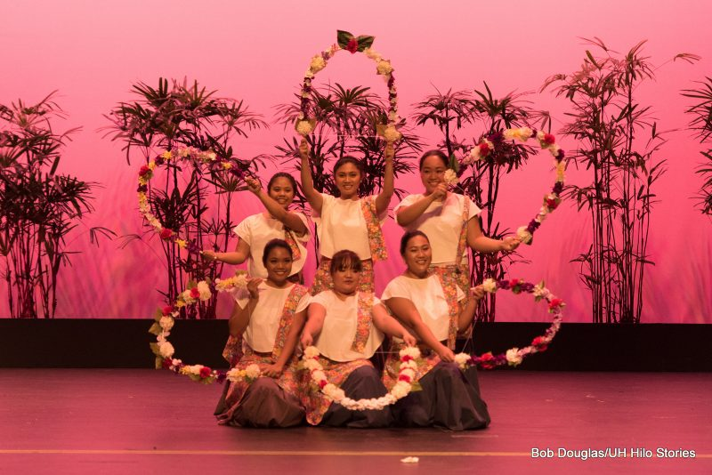 Group photo of female dancers with floral hoops.