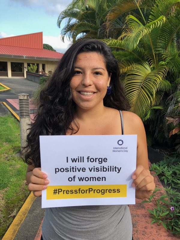 """Holding sign, """"I will forge positive visibility of women"""""""