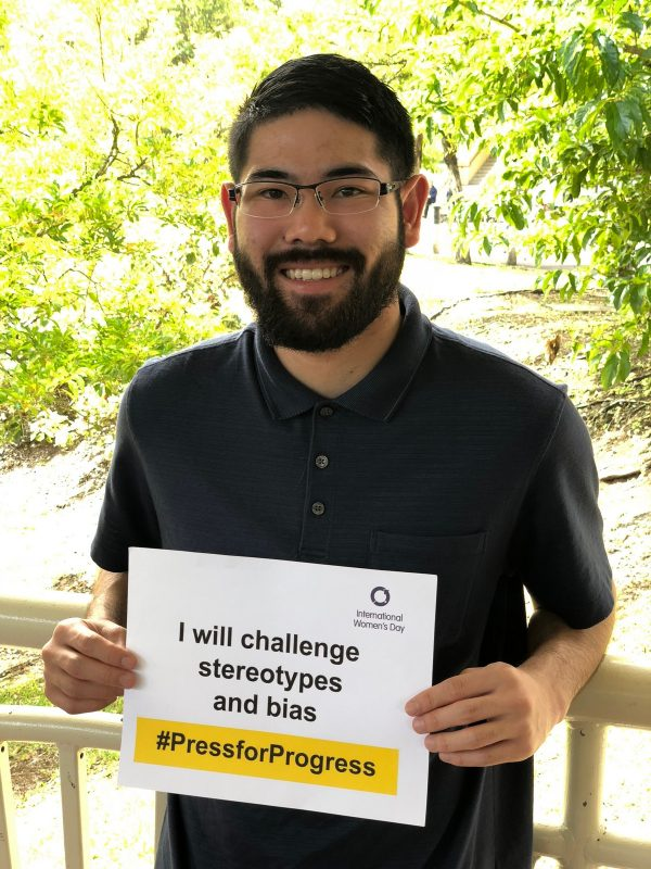 """Holding sign, """"I will challenge stereotypes and bias"""""""