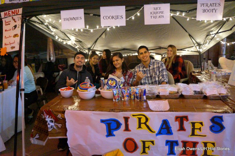 A group at a booth. Sihn reads: PIRATES