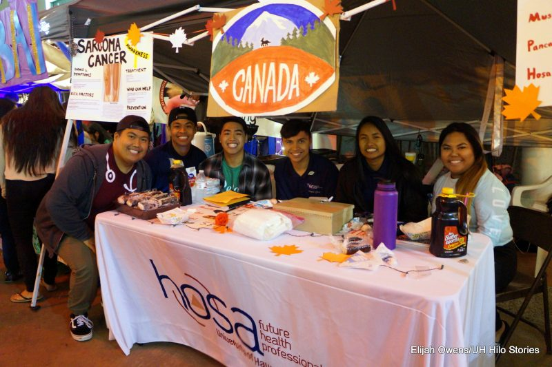 HOSA group at their table. Banner behind table reads CANADA. at left is a poster entitled Sarcoma Cancer. Table drape reads: HOSA Future Health Professionals.