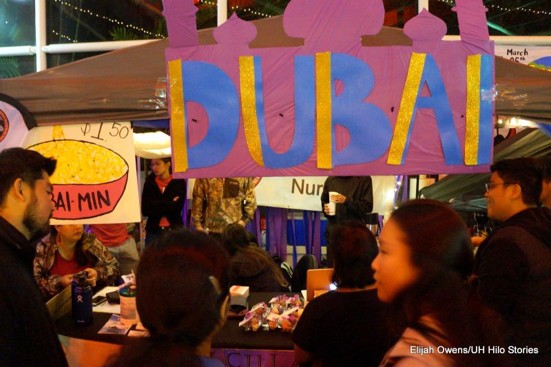 A group at a booth. Sign reads: DUBA