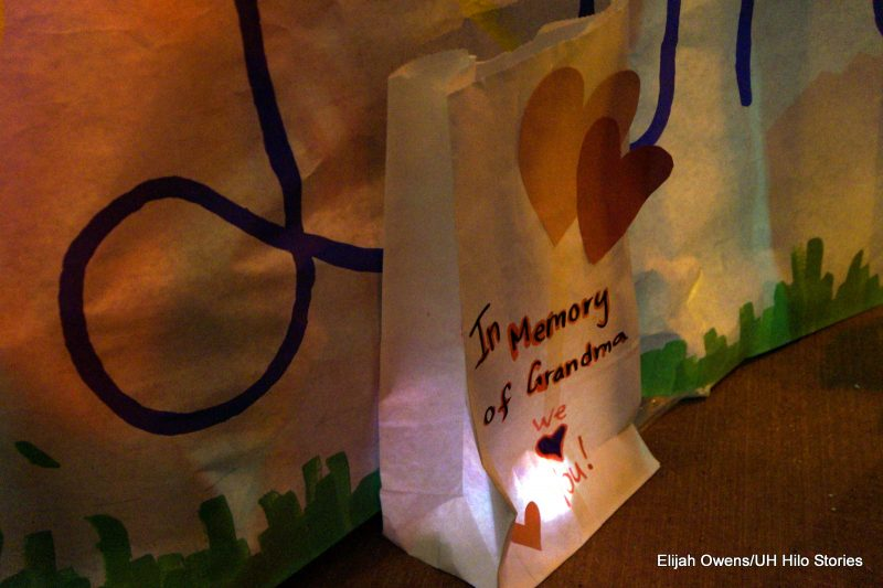 Luminaria, a candle in a white paper bag. Hearts on the outside of the bag.