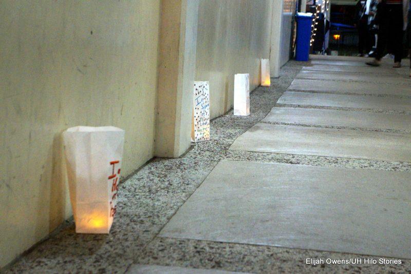 Luminaria in line against building.
