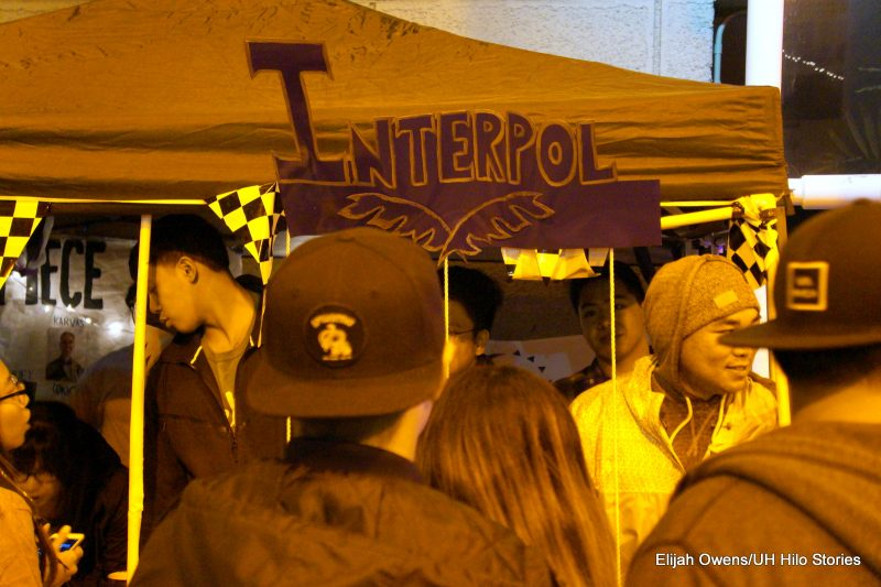 Interpol booth. Lots of people gathered.