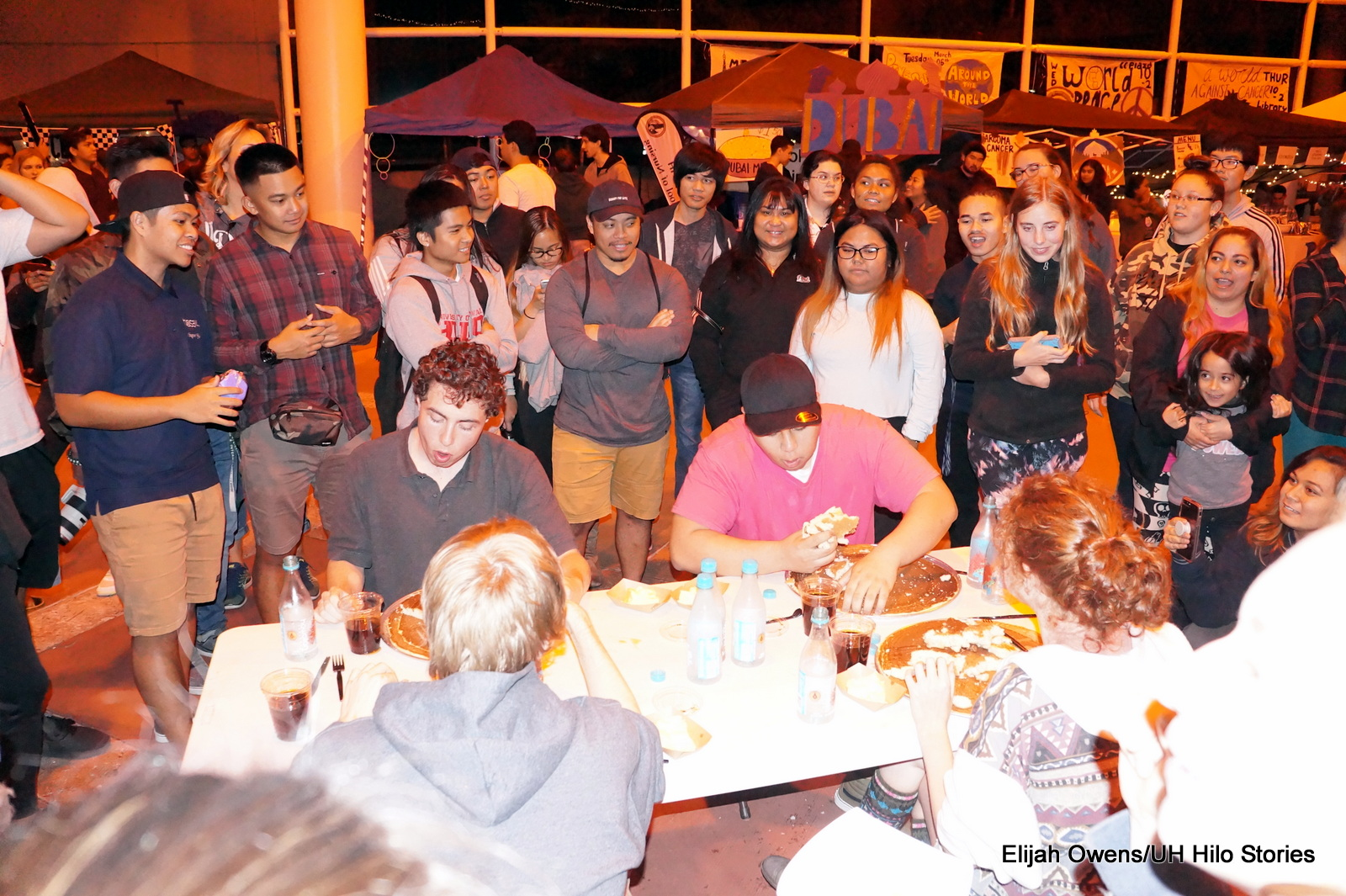 Eating contest, everyone gathered around to watch.