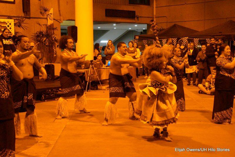 Sāmoan group dancing, men and women.