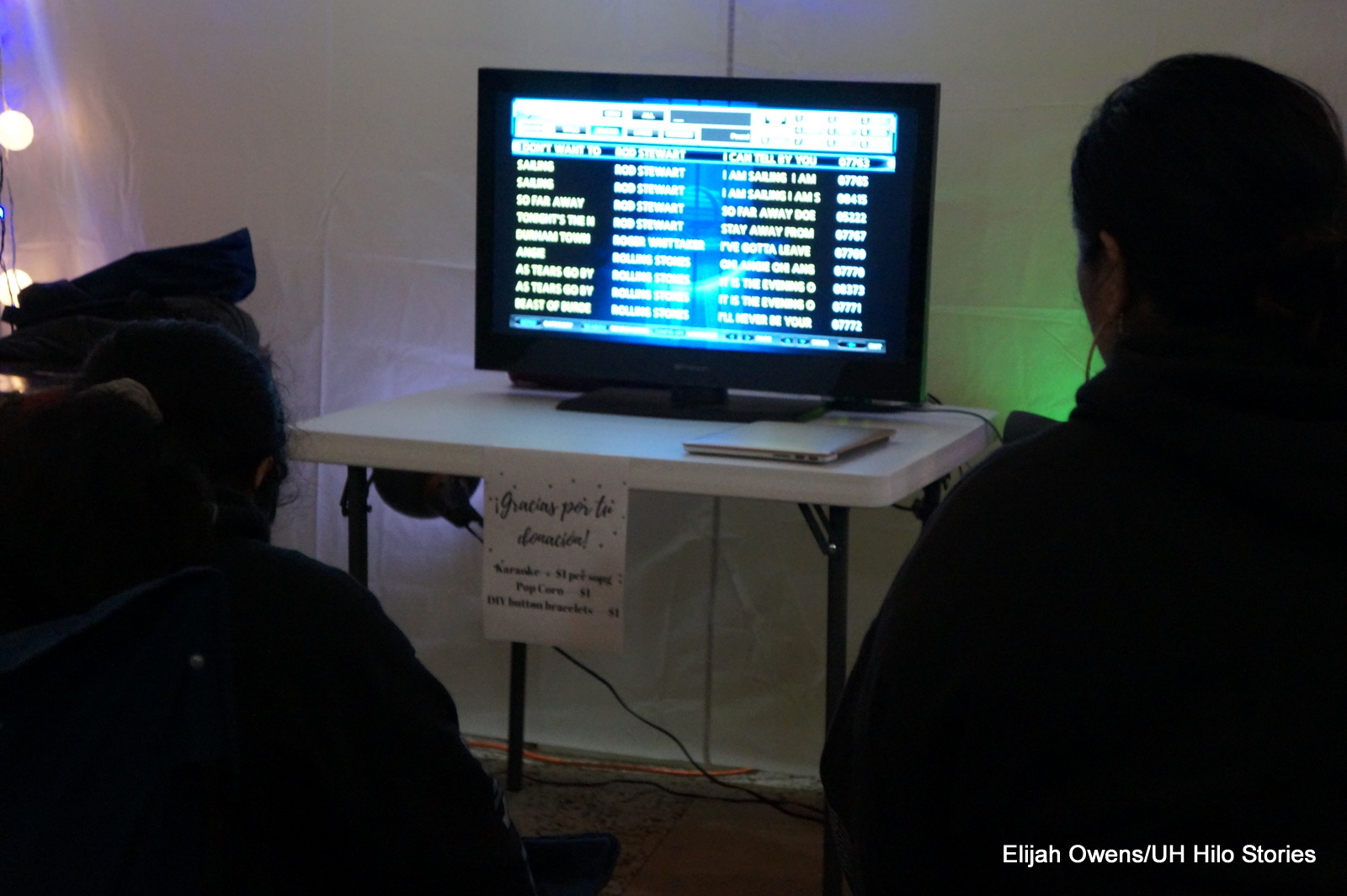 Students playing on a screen.