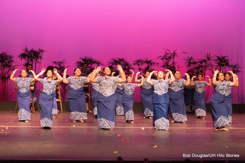 Women dancers in blue puletasi.