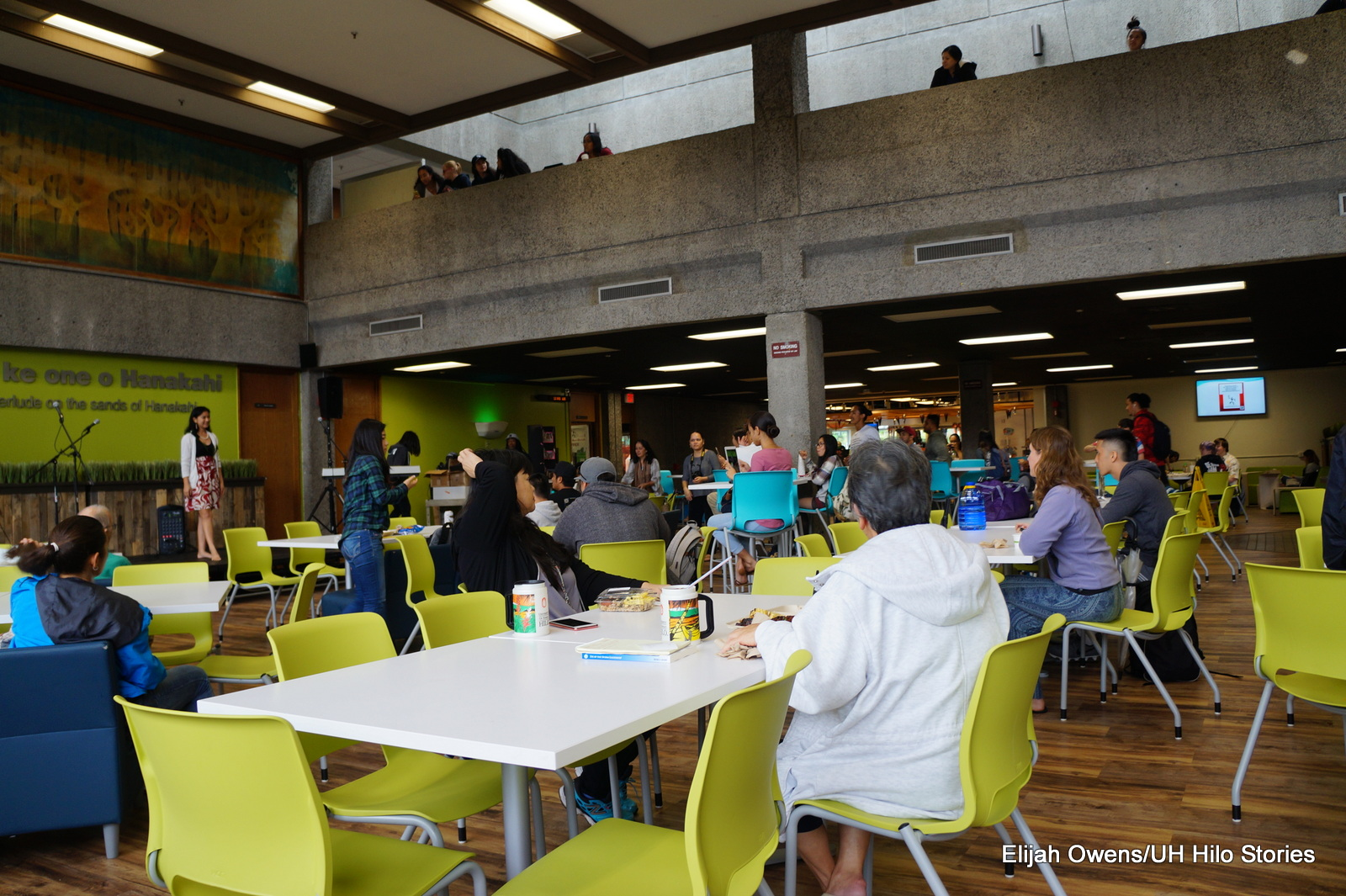 Venue, large dining room, people sitting at cafe tables.