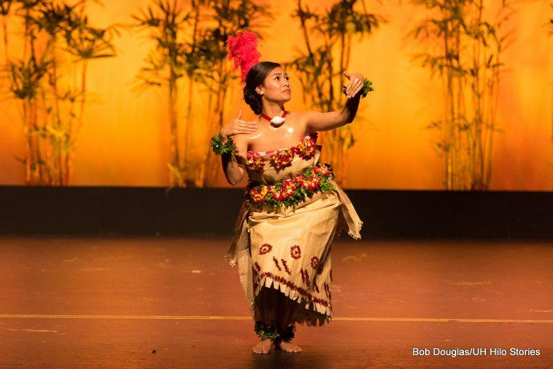 Woman dancing in traditional Ta'ovala.