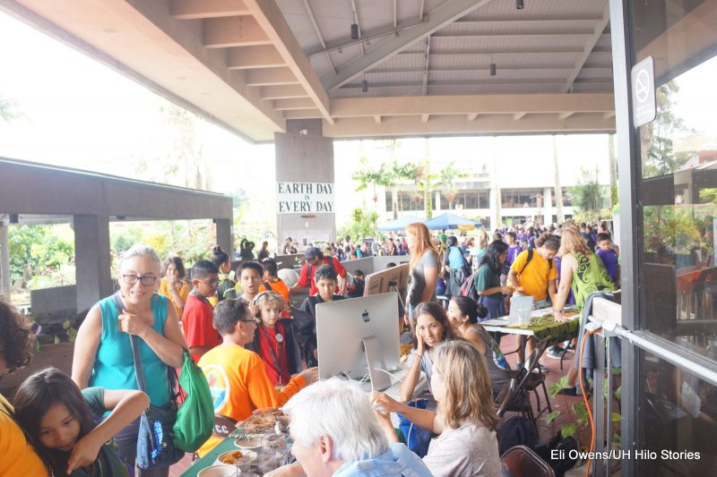 Overall view of the crowd on the library lanai.