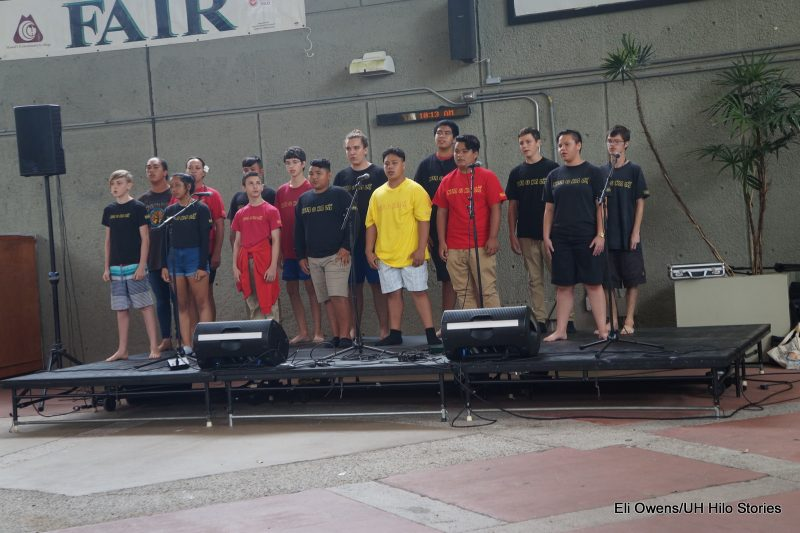 GROUP OF BOYS SINGING ON STAGE..