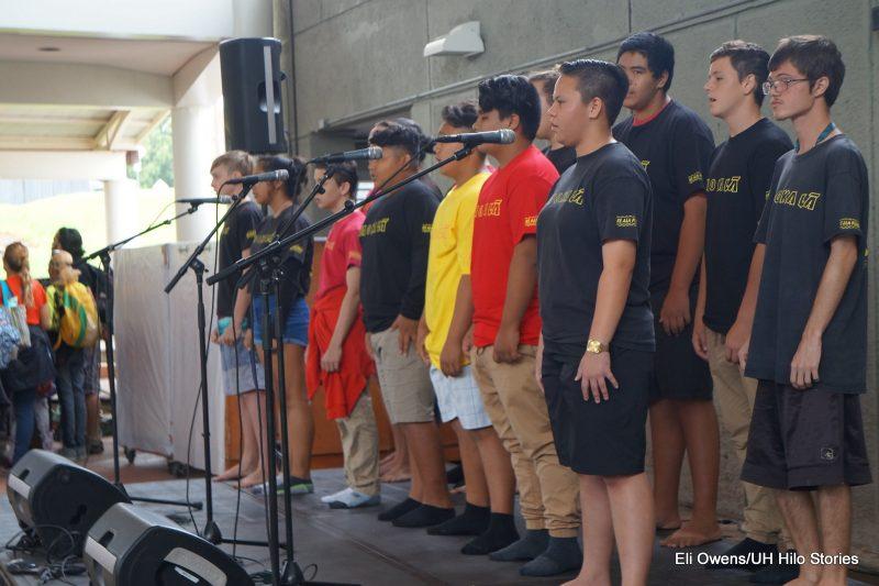 GROUP OF BOYS SINGING.