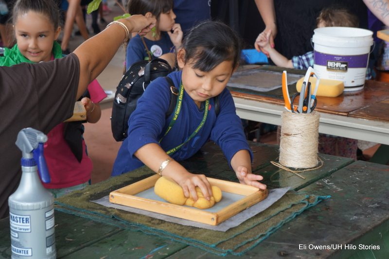 GIRL SPONGING DOWN PAPERMAKING FRAME.