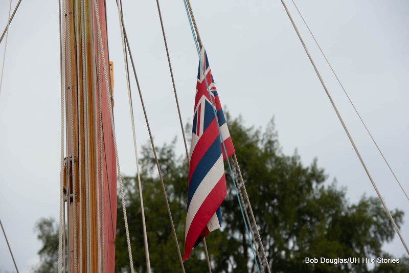 Hawaiian flag hanging on rigging.