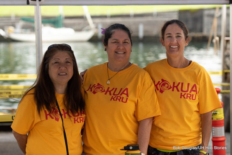 Three women with t-shirts reading KOKUA KRU.