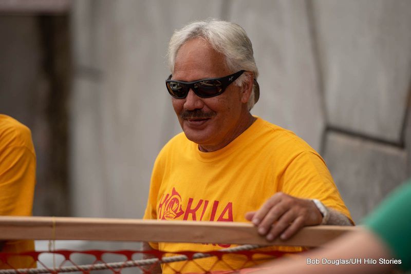 Crew member in t-shirt with the words KOKUA KRU.
