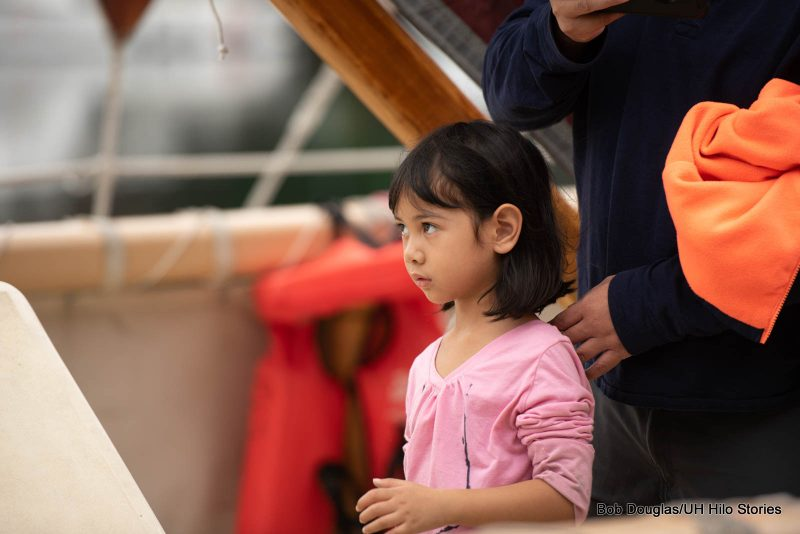 Young girl on the deck of the canoe.
