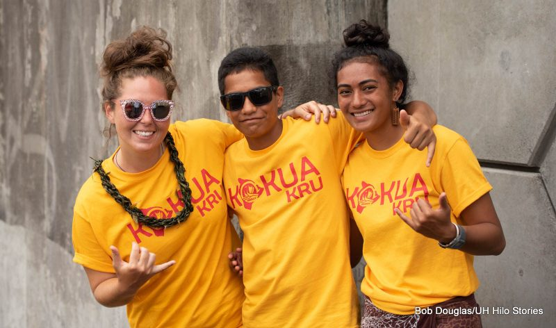 Three crew members in t-shirts with the words KOKUA KRU.