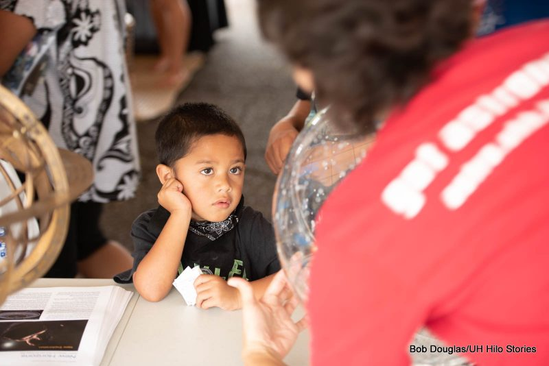 Young boy listening to a adult speak.