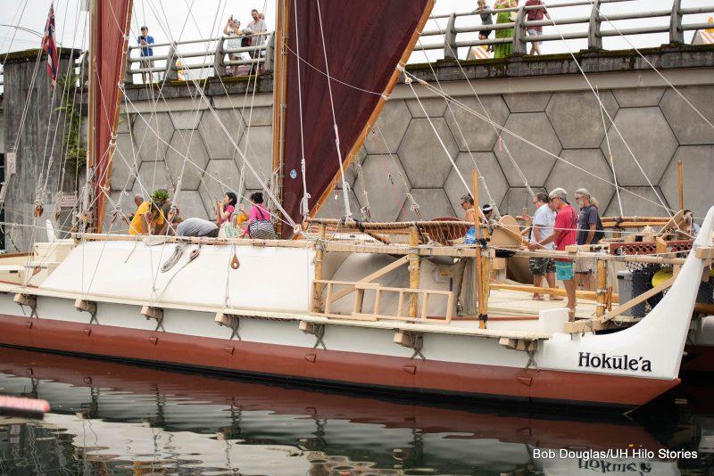 Crowd touring canoe.