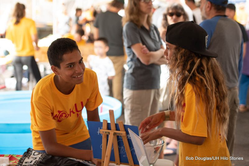 Young man in t-shirt with the words KOKUA KRU.