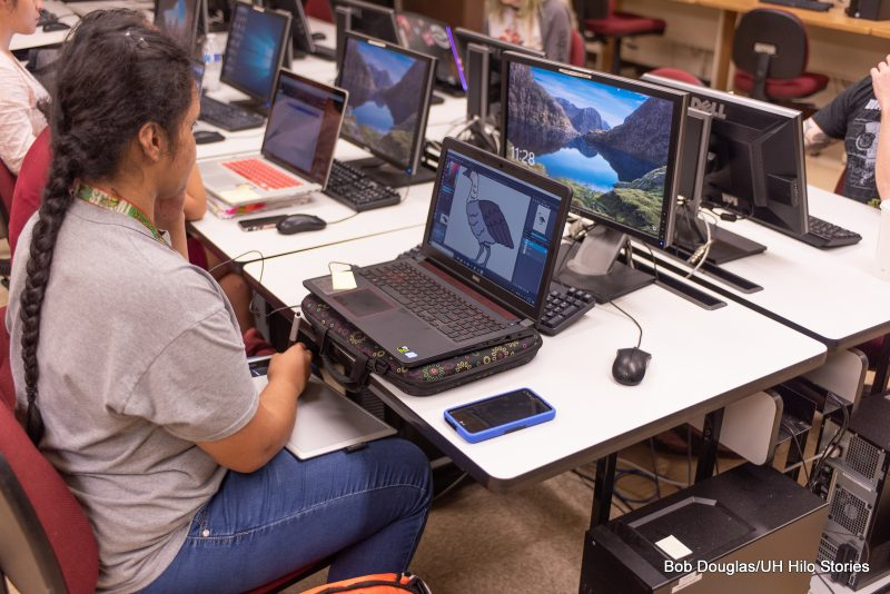 Student at computer with nene on the screen.