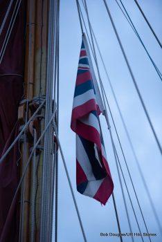 Hawaii flag on the mast of the canoe.
