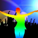 Silhouette of dancer in rainbow colors