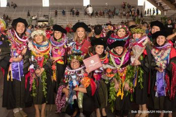 Group photo of graduates with caps and lei.