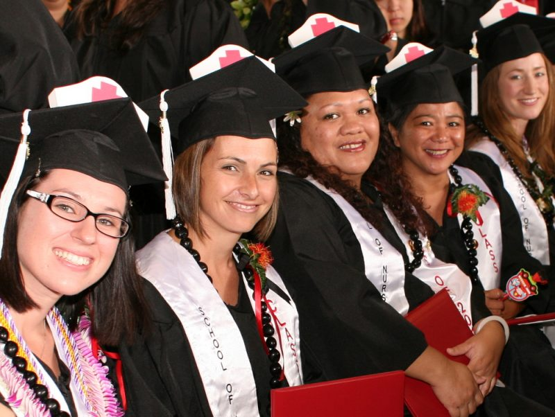 Graduates of Nursing Program in cap and gown at graduation.