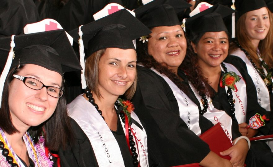 Graduates of Nursing Program in cap and gown at graduation.