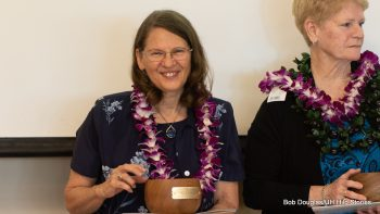 Honoree holds her bowl.