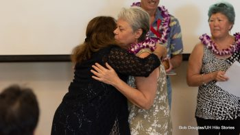 Honoree receives lei and hug.