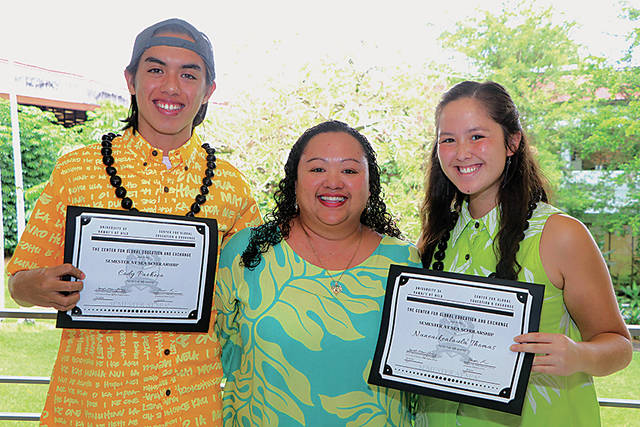 Cody Pacheco, Farrah-Marie Gomes, and Naneaikealaula Thomas stand for photo. Students are holding certificates.