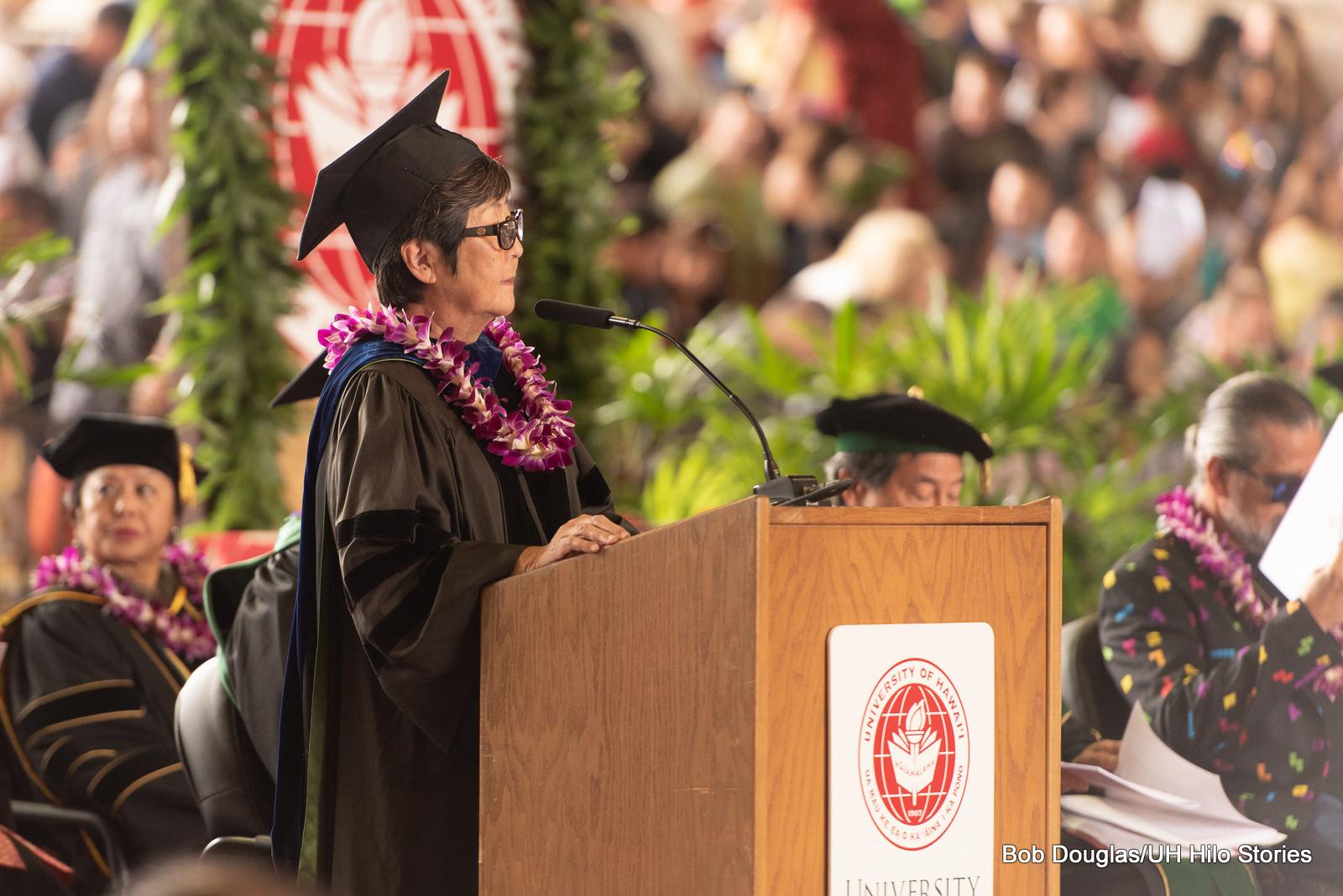 Interim Chancellor Marcia Sakai at podium.