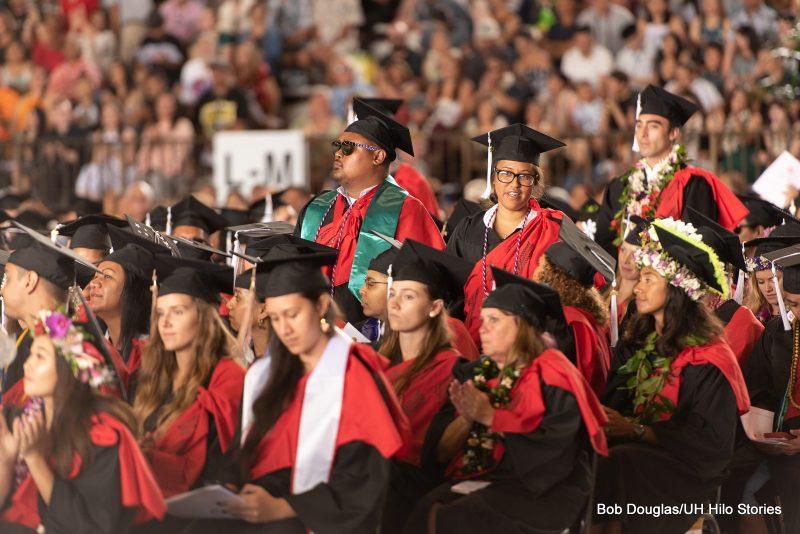 Graduates stand.