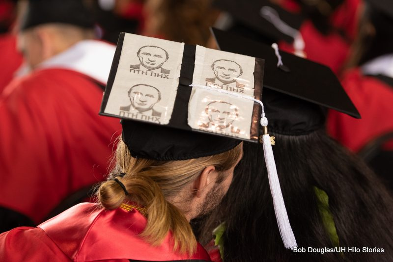 Mortarboard with four images of Putin.