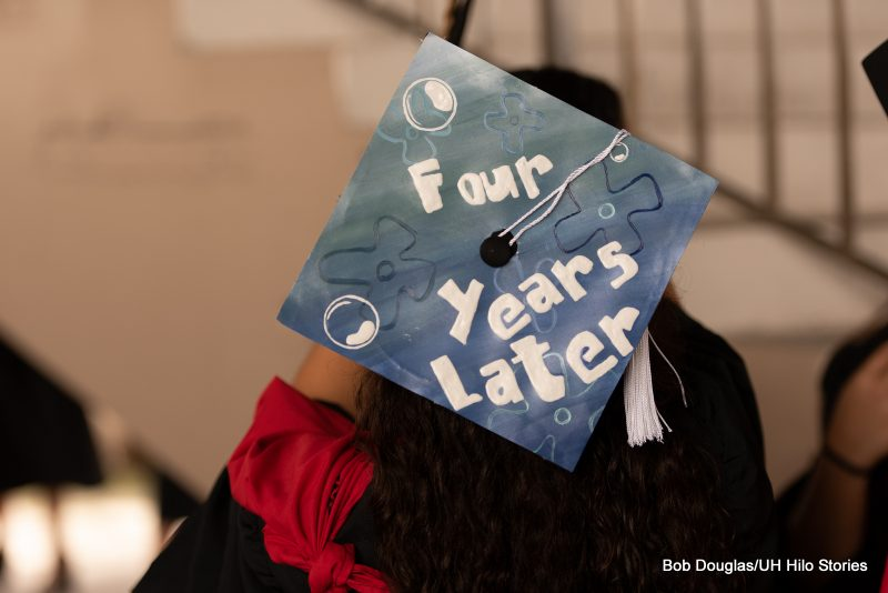 Mortarboard with the words: Four Years Later